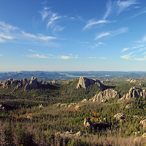 "View over the Black Hills National Forest. According to the environmentalist organization ""Defenders of the Black Hills,"" there are more than 270 unsealed uranium mine shafts and thousands of contaminated exploration wells in this region alone. Many are fi lled with water and there is the constant danger of leaks and spills. Photo credit: Navin75 / creativecommons.org/licenses/ by-sa/2.0"