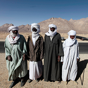 2010: Victims of radiation exposure standing outside the former test site of In Ekker, about 170 km away from the town of Tamanrasset. Radioactive material continues to seep out of the mountain, where France conducted its nuclear tests, and contaminates local soil and ground water. Photo: © Zohra Bensemra/Reuters/Corbis