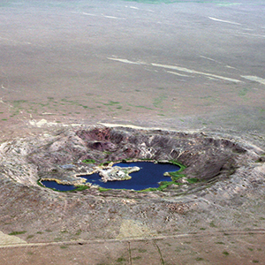 A crater on the Semipalatinsk Test Site in the steppes of Kazakhstan. After the country's independence in 1991, the Kazakh government closed down the site and returned its nuclear weapon stockpiles to Russia – at that time the fourth largest nuclear arsenal in the world. Photo: © CTBTO Preparatory Commission